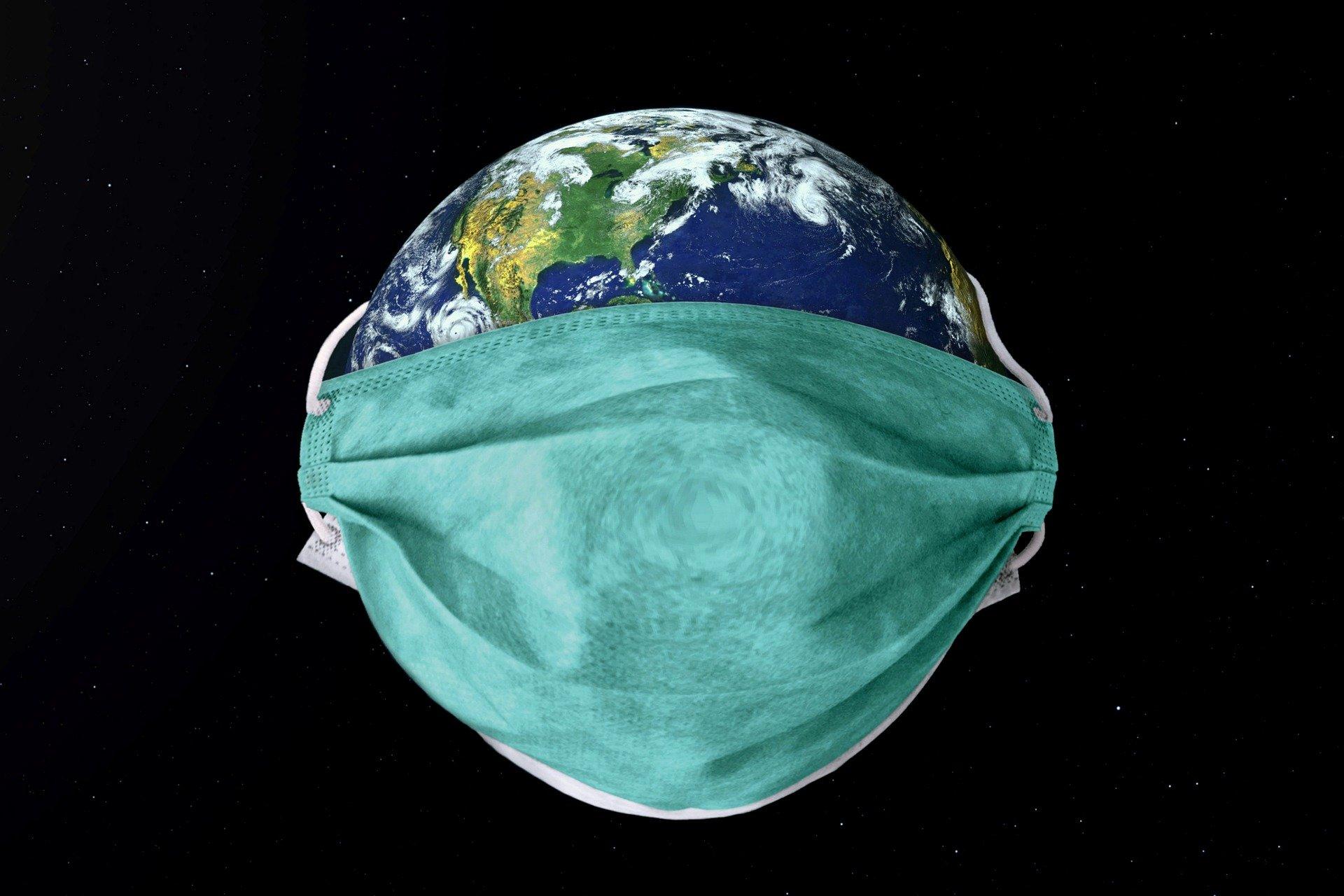 Máscara em torno do planeta terra sob coronavírus