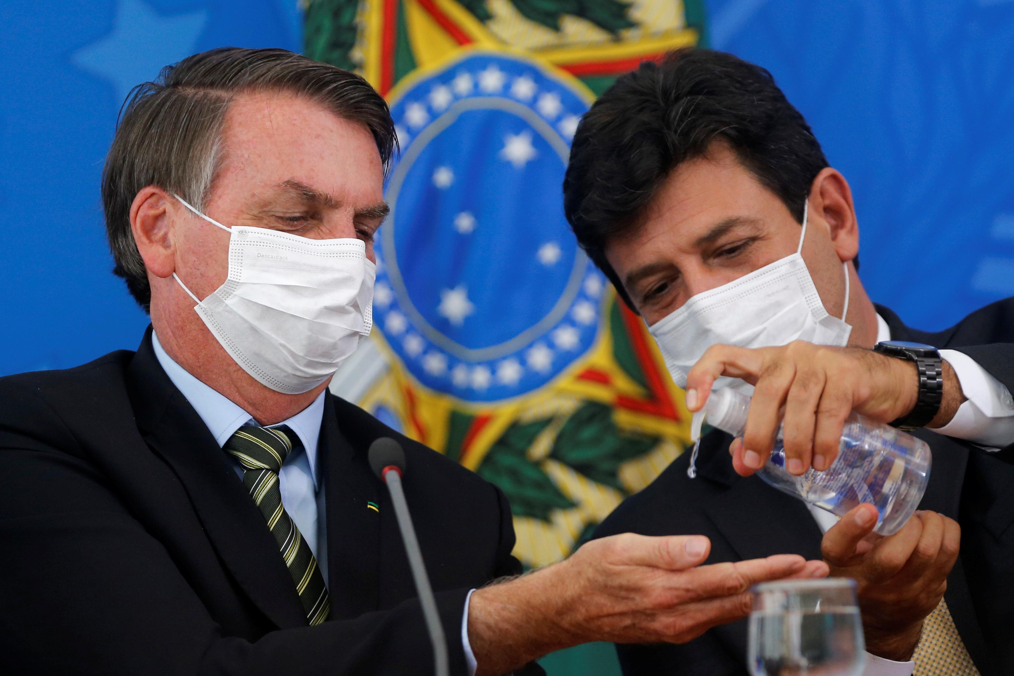 O presidente  Jair Bolsonaro, e o ministro da Saúde, Luiz Henrique Mandetta