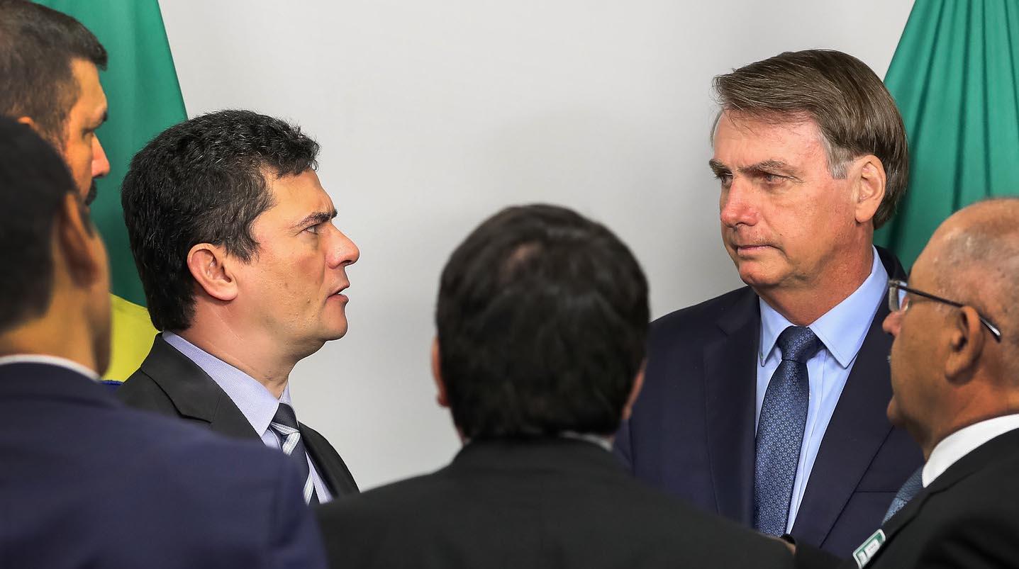 O presidente Jair Bolsonaro e Sergio Moro em reunião do Ministério da Justiça