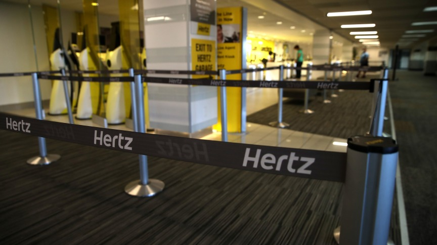 SAN FRANCISCO, CALIFORNIA - APRIL 30: Stanchions with Hertz logo sit in an empty Hertz Rent-A-Car rental office at San Francisco International Airport on April 30, 2020 in San Francisco, California. According to a report in the Wall Street Journal, car rental company Hertz is preparing to file for bankruptcy as the travel industry has come to a standstill due to the coronavirus (COVID-19) pandemic. (Photo by Justin Sullivan/Getty Images)
