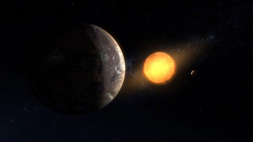 Ilustração de Kepler-1649c orbitando ao redor de sua pequena estrela hospedeira. Este recentemente descoberto exoplaneta está na área habitável da sua estrela e é o mais parecido com a Terra em tamanho e temperatura descoberta até agora