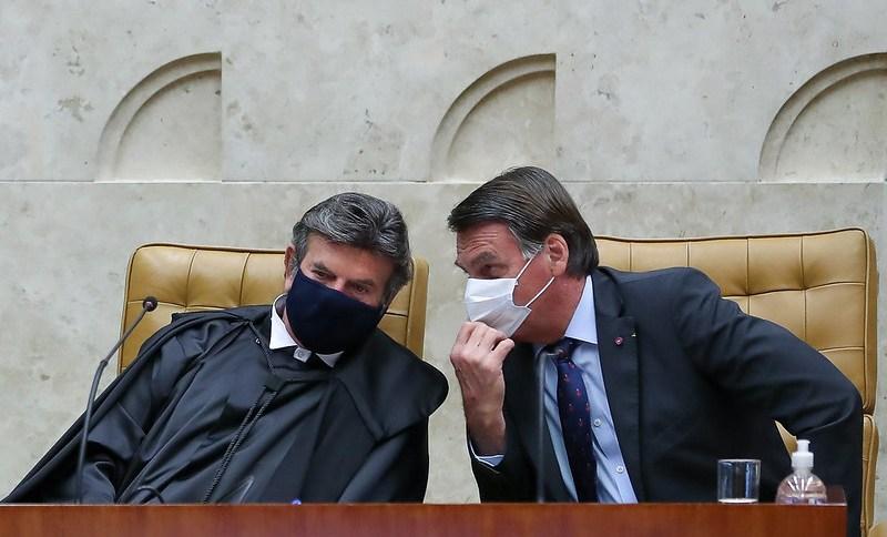 Luiz Fux e Jair Bolsonaro durante evento no Supremo Tribunal Federal (STF)