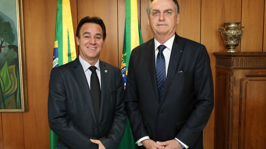 O presidente Jair Bolsonaro e Adilson Barroso, presidente nacional do partido Patriota