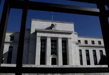 As autoridades do Fed querem o programa de compra de títulos encerrado antes de qualquer aumento nos custos de empréstimos.