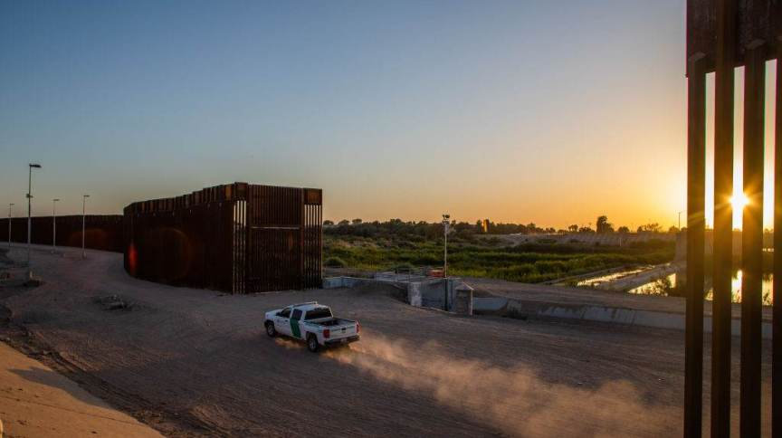 YUMA, AZ - MAY 12: A border patrol truck drives by the wall at the US-Mexico border on May 12, 2021 in Yuma, Arizona. The Biden administration is trying to develop a plan to safely handle the surge of immigrants coming across the Southern border. (Photo by Apu Gomes/Getty Images)