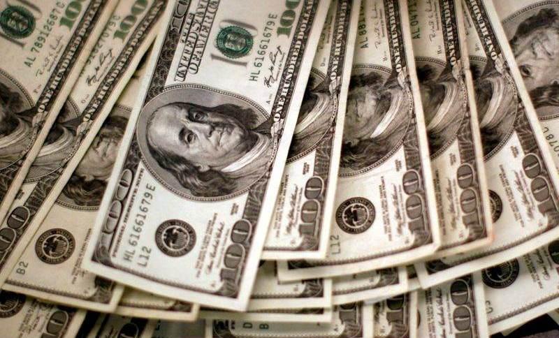 Dólar acompanha recuperação do apetite por risco global e cede terreno ante real